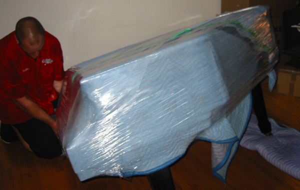 How-to-Move-a-Piano-Upstairs-wrap-up-with-blanket