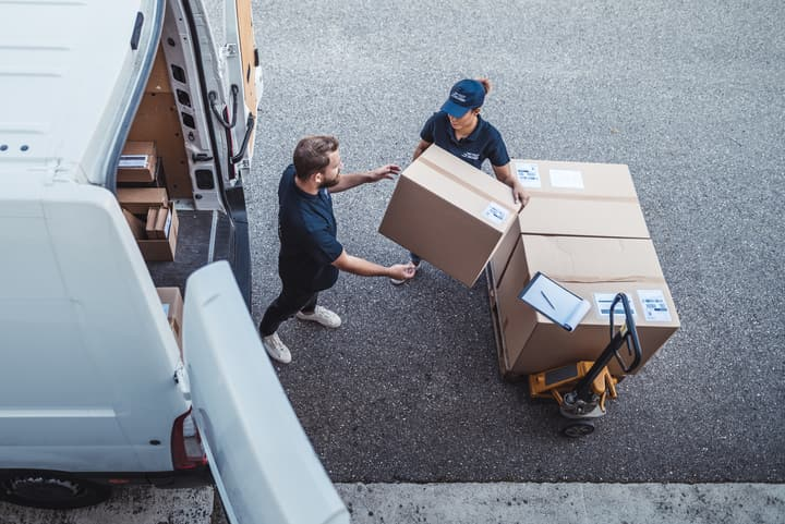 load packages in a delivery van